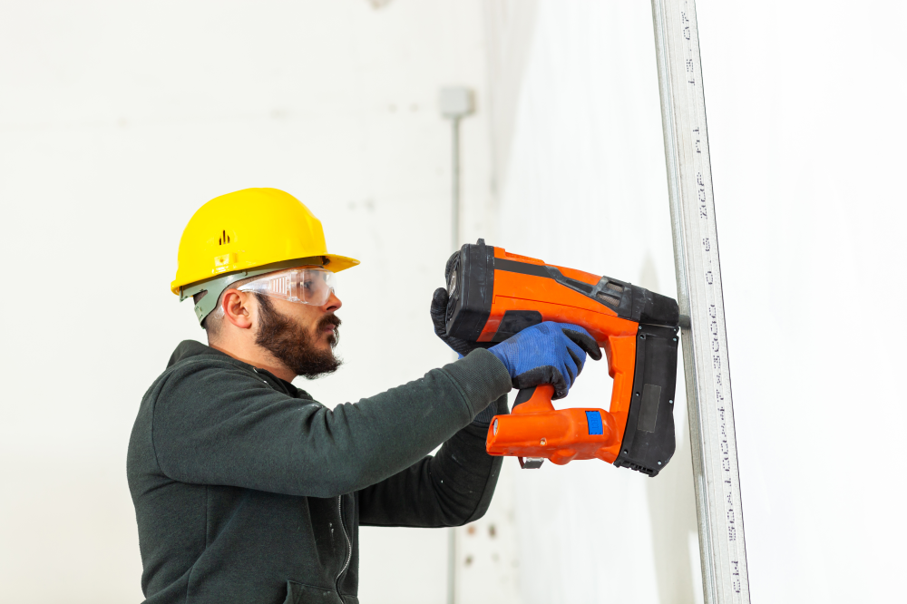 Worker Screwing On Plasterboard